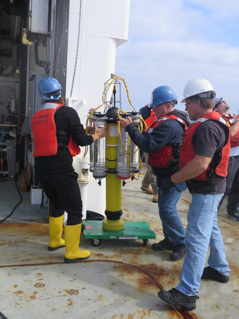 Collecting an NBST onto the deck of the r/v Sally Ride. (Photo by Samantha Clevenger)